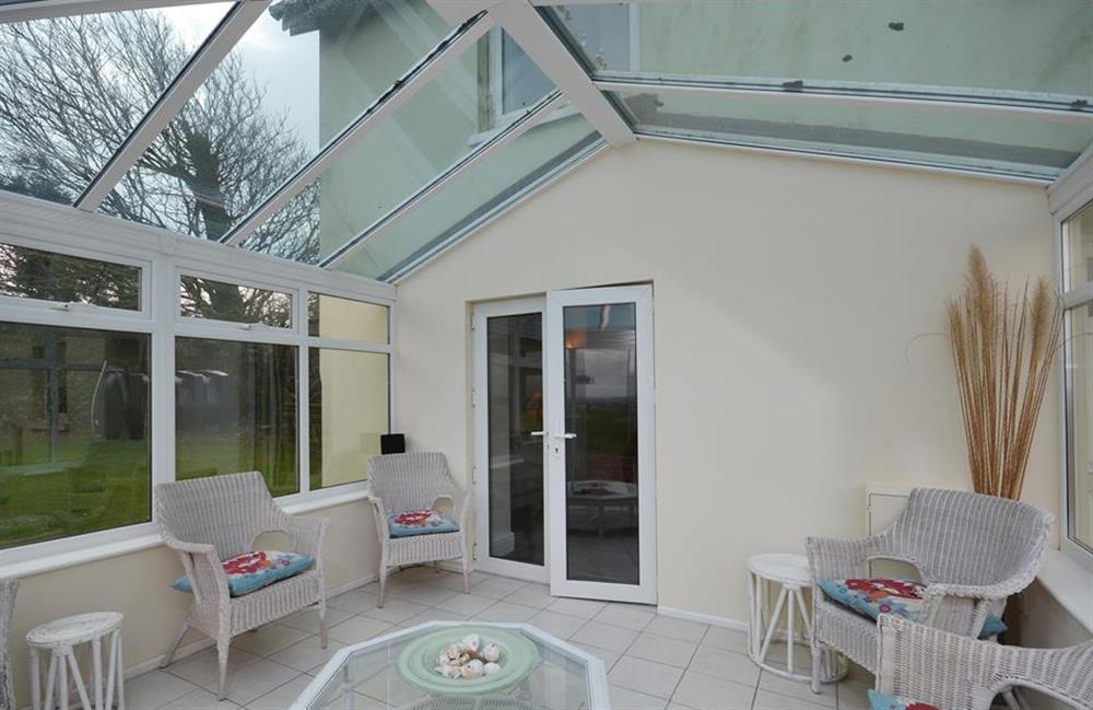 Another view of the conservatory leading to the lounge at Foxenhole Farmhouse, Dittisham