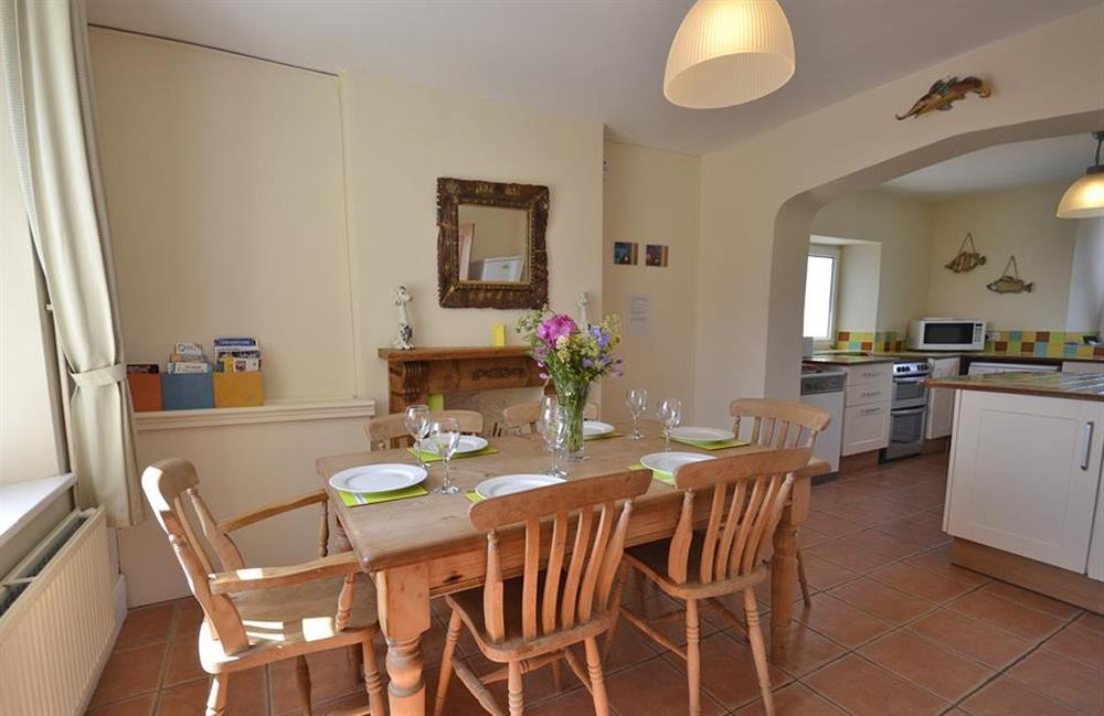 The dining area leading into the kitchen at Foxenhole Farmhouse, Dittisham