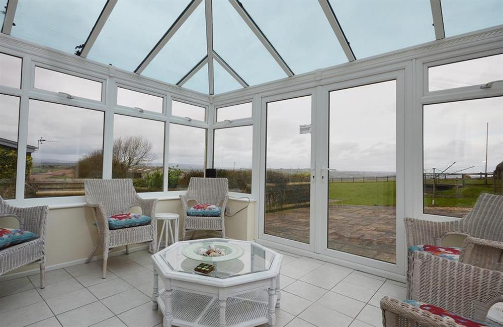 The light and airy conservatory at Foxenhole Farmhouse, Dittisham