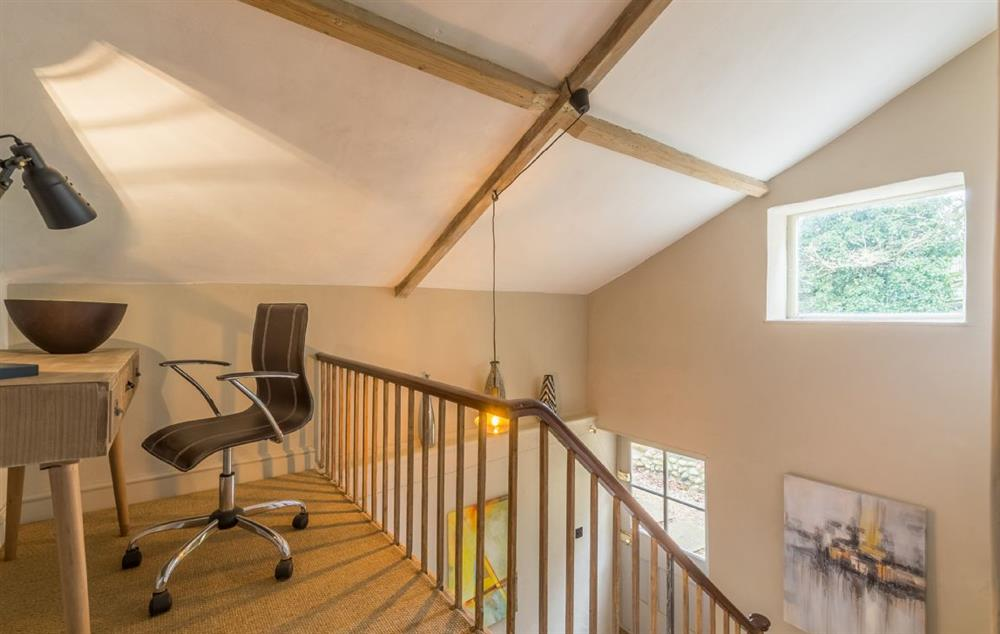 First floor:  Galleried landing with contemporary desk and chair