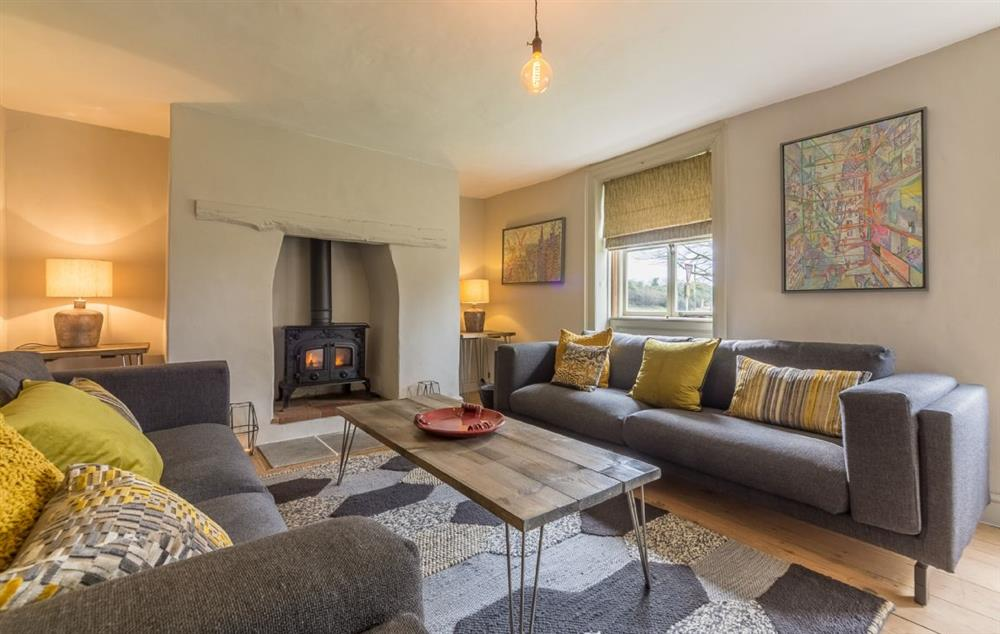 Ground floor:  Sitting room with wooden floor and contemporary sofas