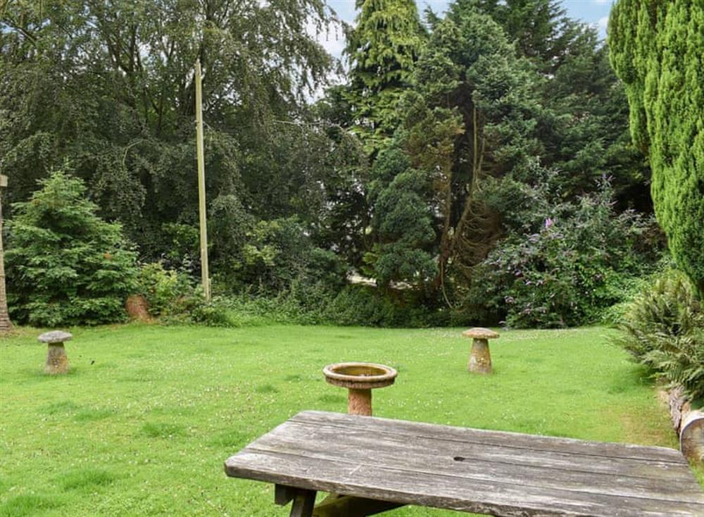 Large, enclosed lawned garden with sitting-out area (photo 2) at Garden Cottage in Hendham, near Kingsbridge, Devon
