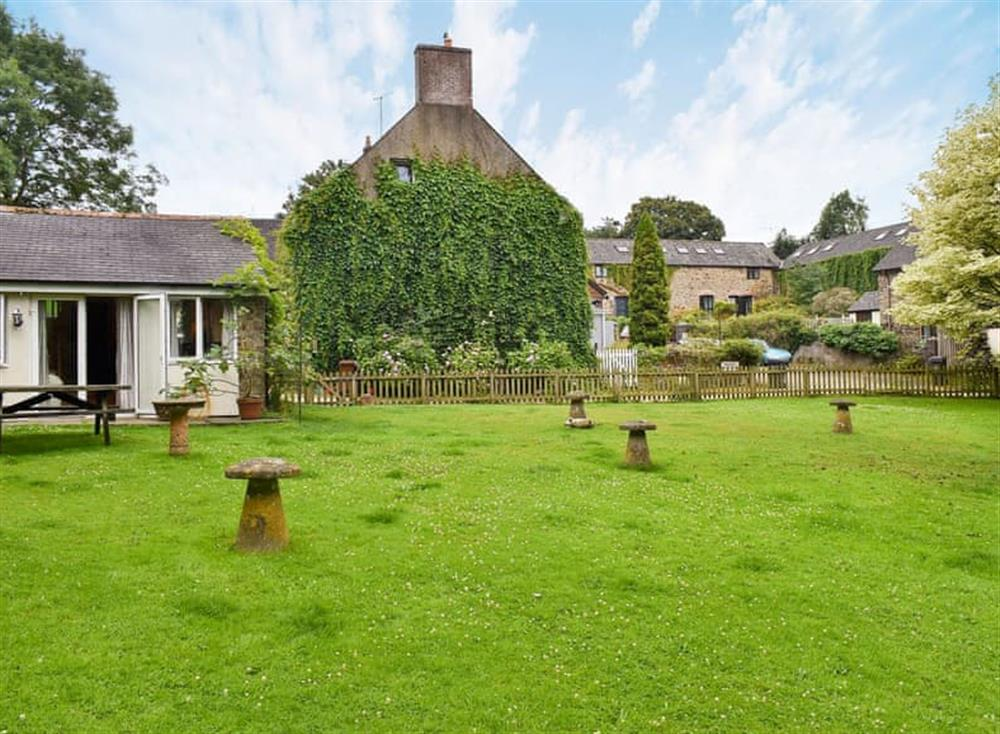 Large, enclosed lawned garden with sitting-out area at Garden Cottage in Hendham, near Kingsbridge, Devon