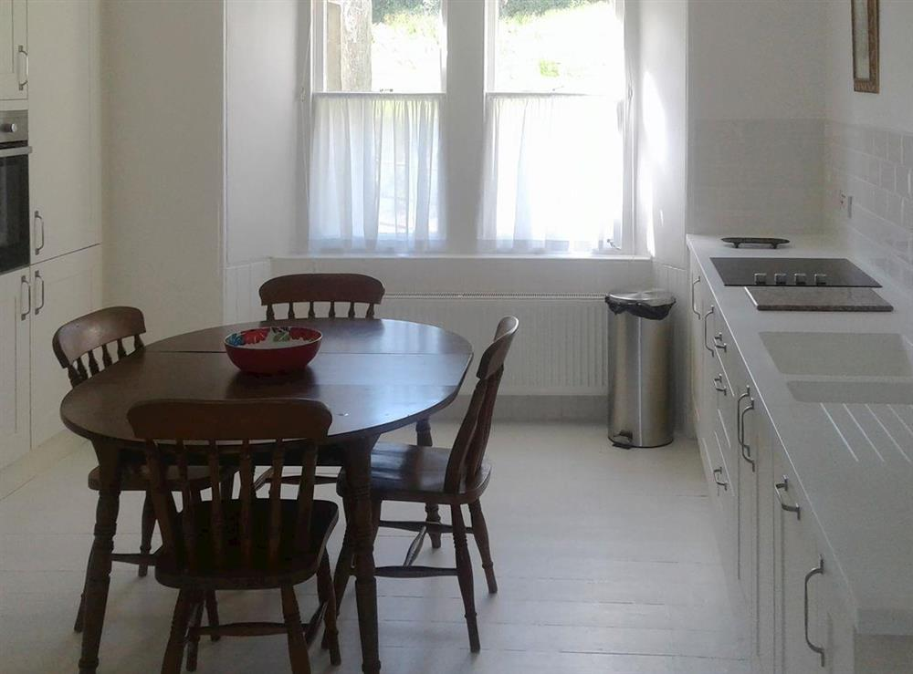 Inviting kitchen and dining area at Garden Cottage in Strachur, near Dunoon, Argyll and Bute, Scotland