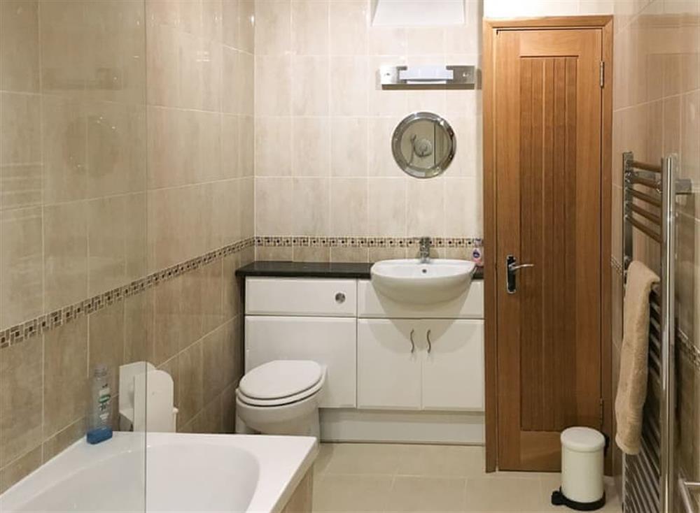 Beautiful bathroom with shower over the bath at Gemstone Cottage in Brixham, Devon