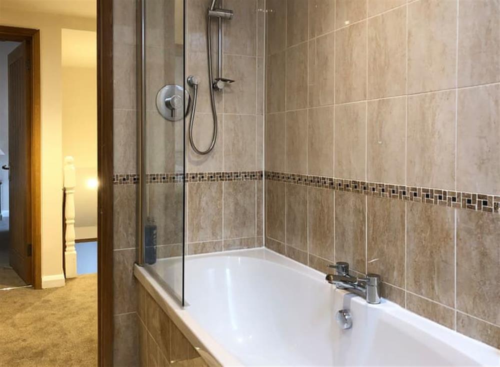 Exquisite bathroom with shower over the bath at Gemstone Cottage in Brixham, Devon