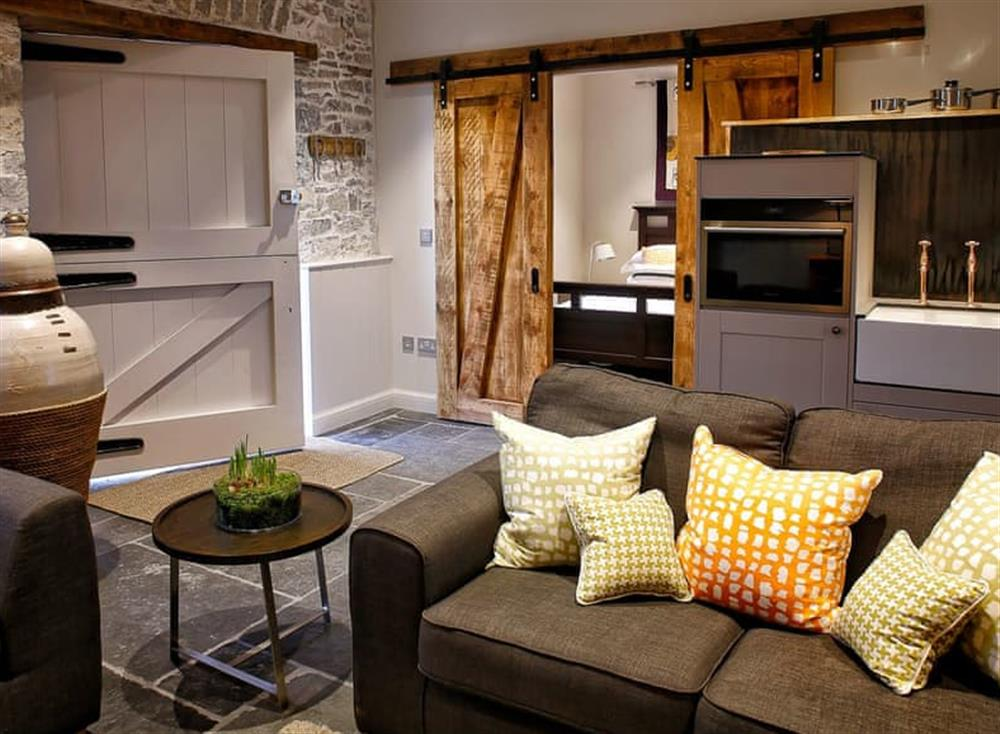 Convenient open-plan living space at The Stables,
