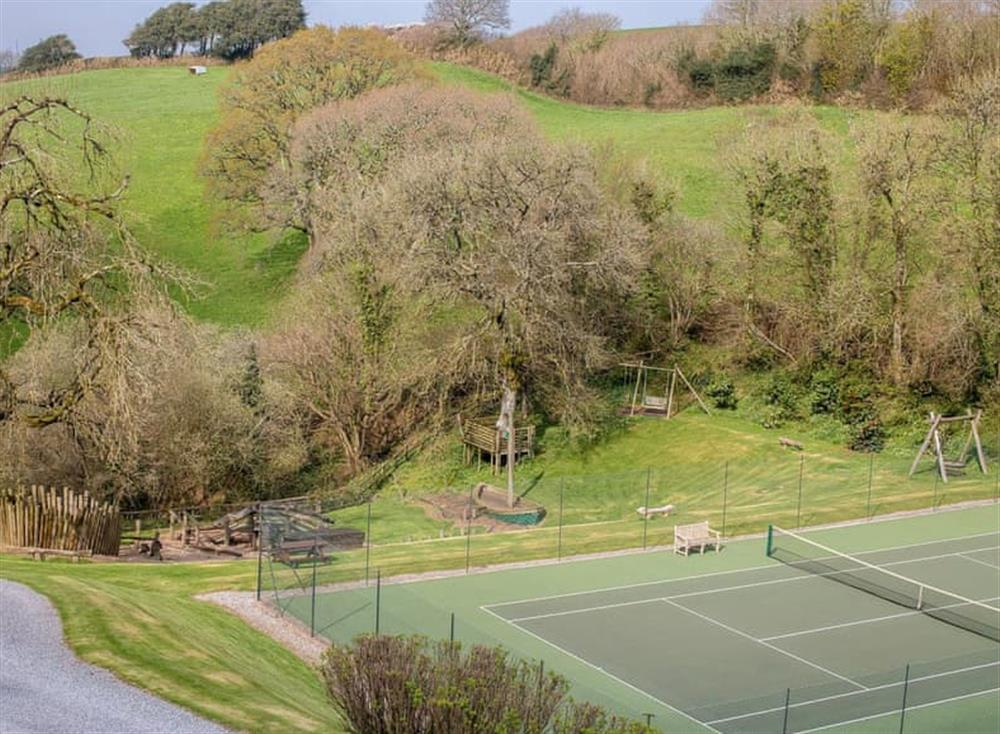14-acre grounds with tennis court and children's play area at Garden House,