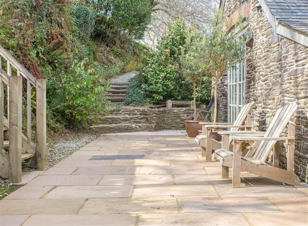 Enclosed patio with garden furniture and barbecue at Garden House,