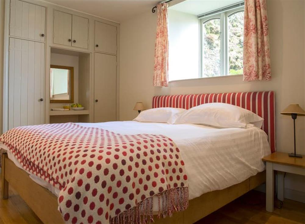 Relaxing bedroom with super kingsize bed at Garden House,