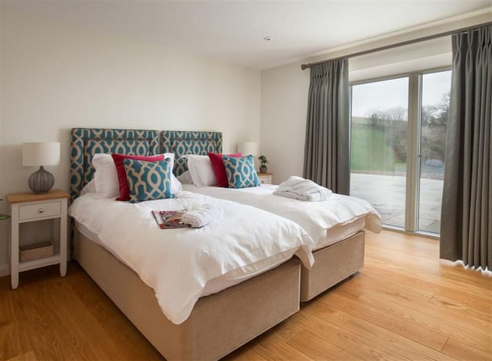 Comfortable twin bedroom at Gitcombe Retreat,