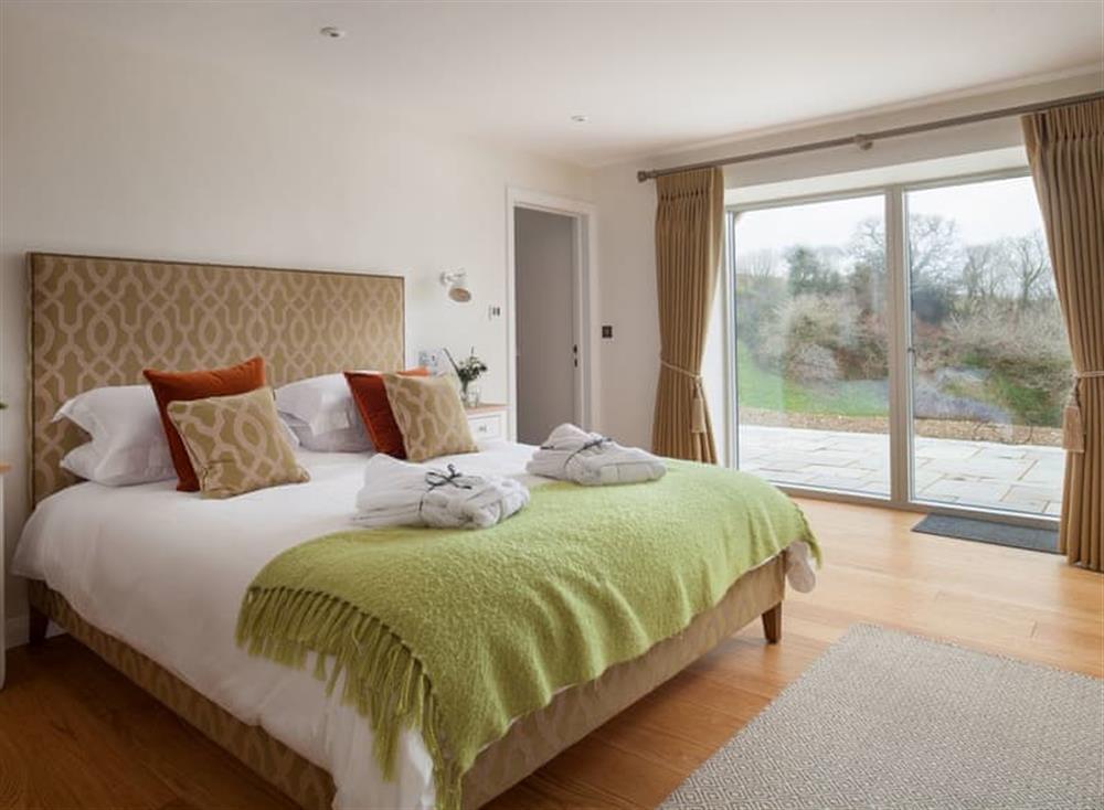 Relaxing en-suite double bedroom at Gitcombe Retreat,
