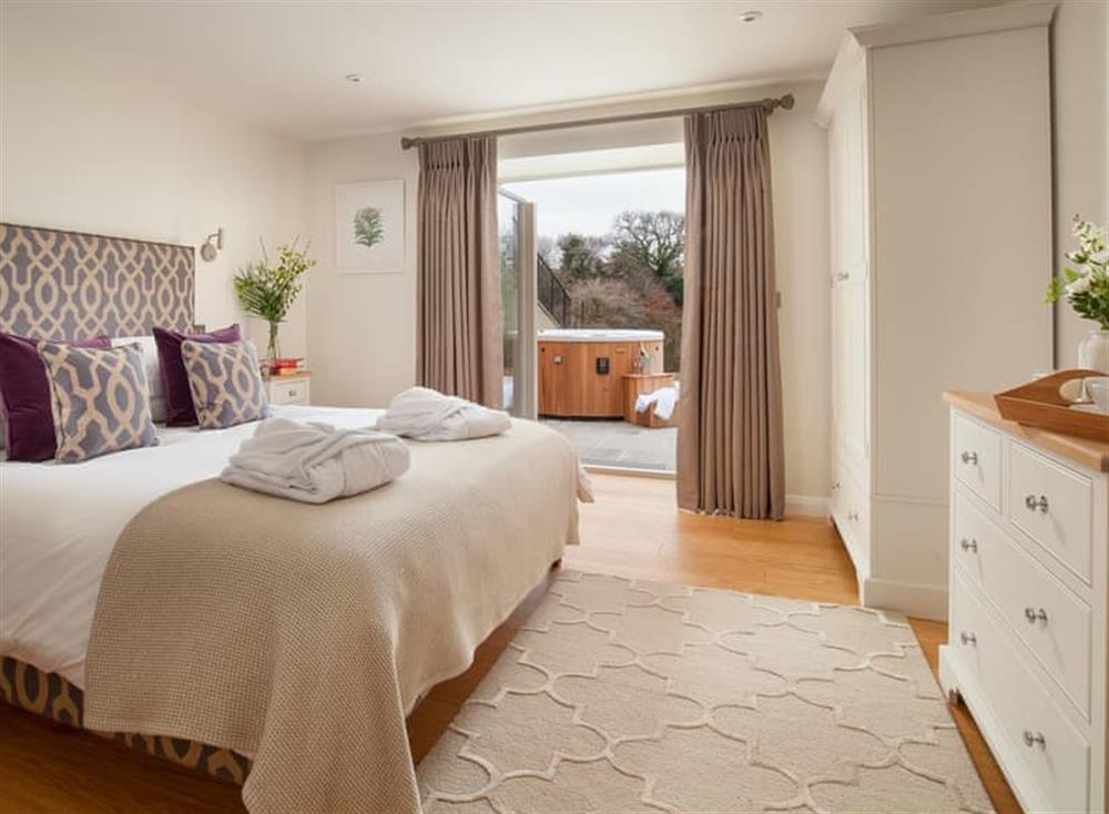 Stylish en-suite double bedroom with door to patio area at Gitcombe Retreat,