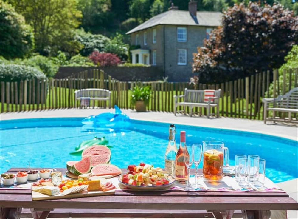 Shared outdoor swimming pool at Haytor Cottage,