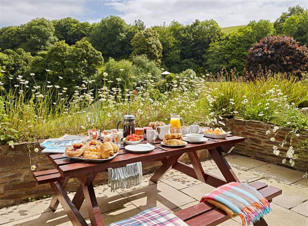 Delightful patio area at Meavy Cottage,