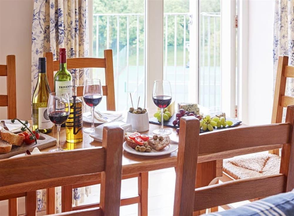 Light and airy dining area at Meavy Cottage,