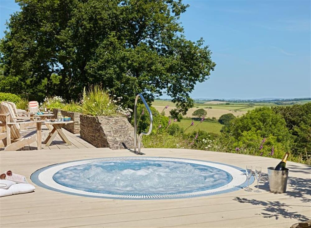 Outstanding rural views from the sunken hot-tub at Meavy Cottage,