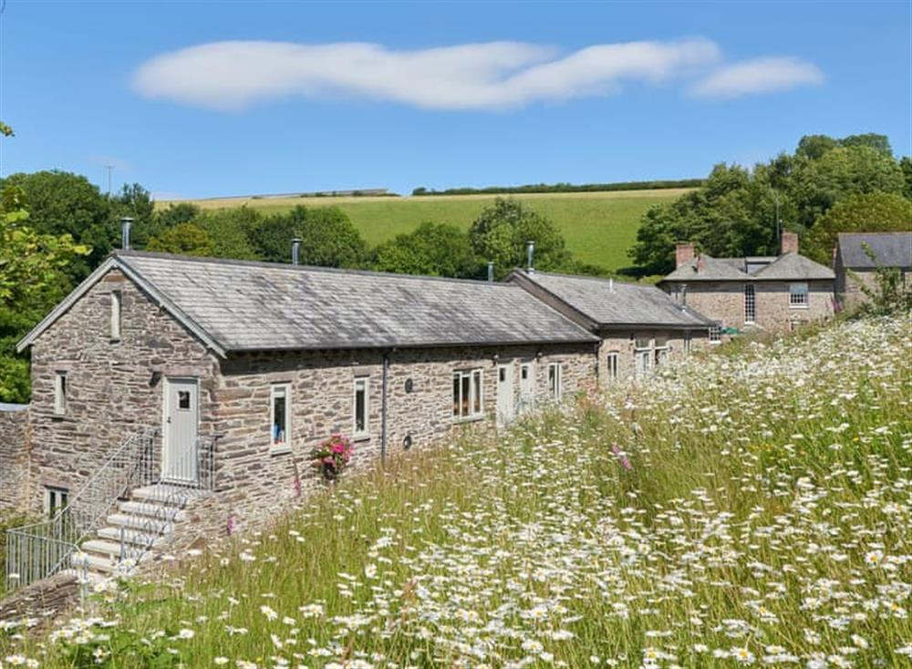 Picturesque view over the varied attractive accommodation at Meavy Cottage,