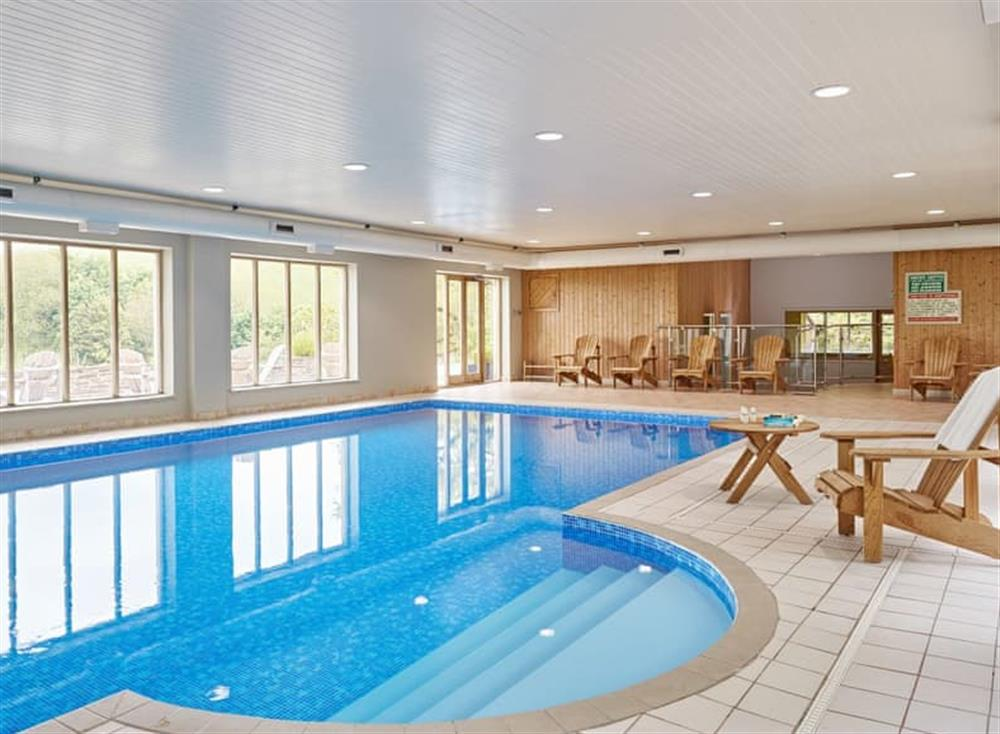 Shared indoor heated swimming pool at Meavy Cottage,