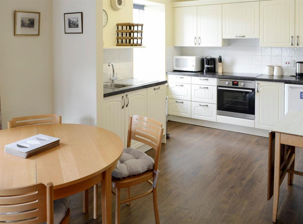 Spacious dining area and well-equipped fitted kitchen at Birch Cottage,