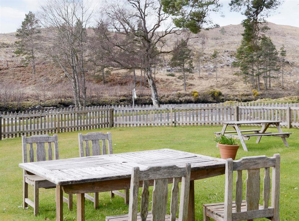 Large enclosed lawned garden with outdoor furniture at Rowan Cottage,