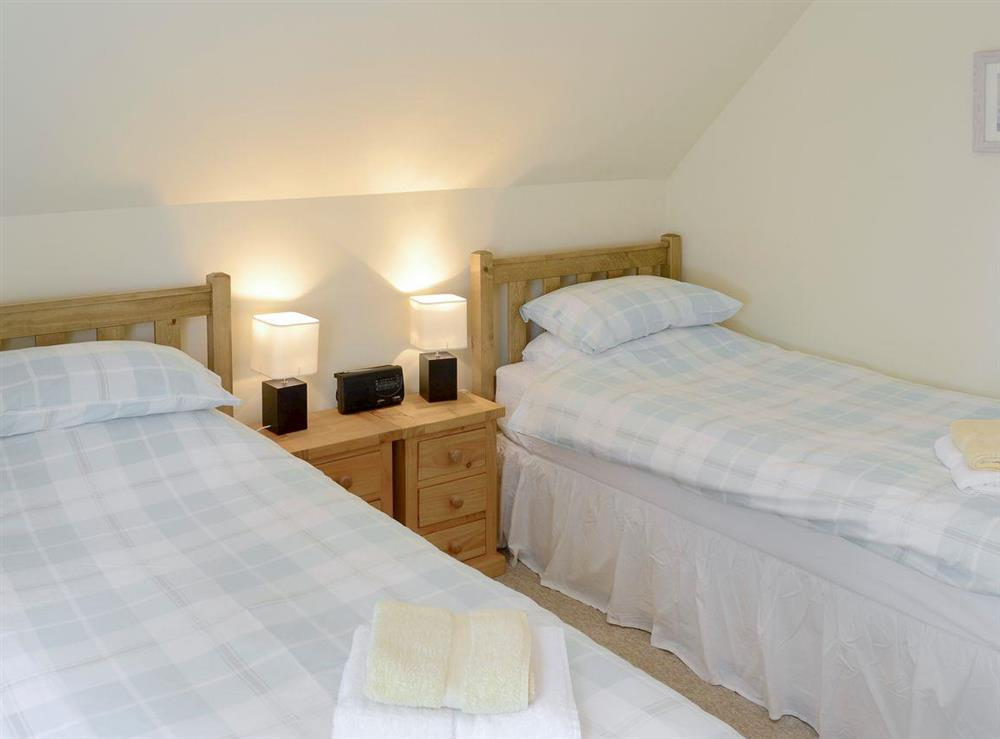 Relaxing twin bedroom at Rowan Cottage,