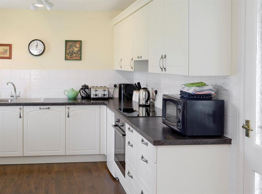 Well-equipped fitted kitchen at Rowan Cottage,
