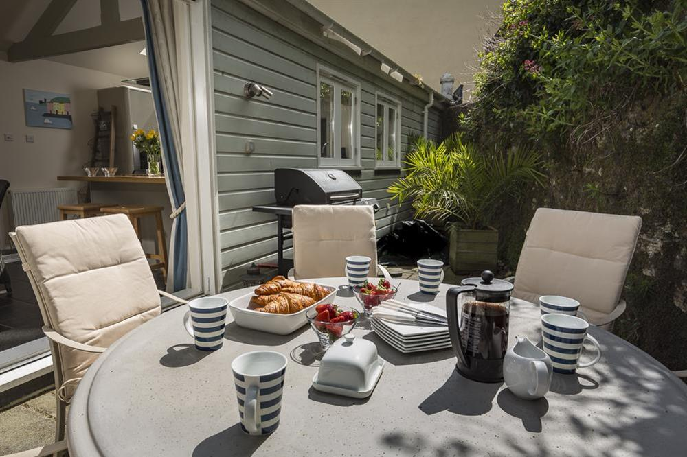 Furnished rear terrace ideal for al fresco dining at Gooder House in , Dartmouth