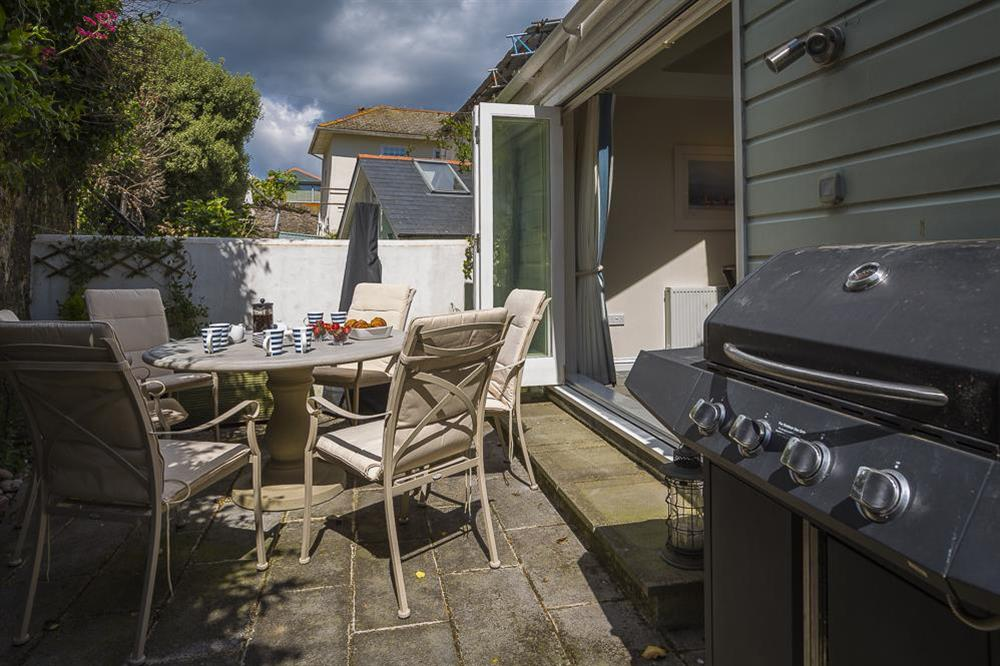 Furnished rear terrace with barbecue at Gooder House in , Dartmouth