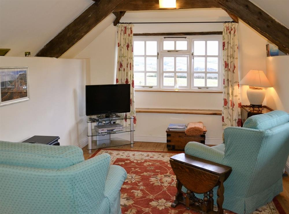 Living room/dining room at Granary Cottage in Diptford, Devon