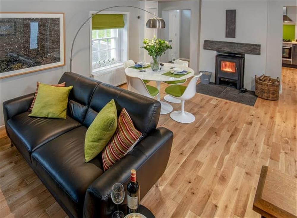 Delightful living/ dining room with wood burner at Granary in Gatehouse of Fleet, Kirkcudbrightshire