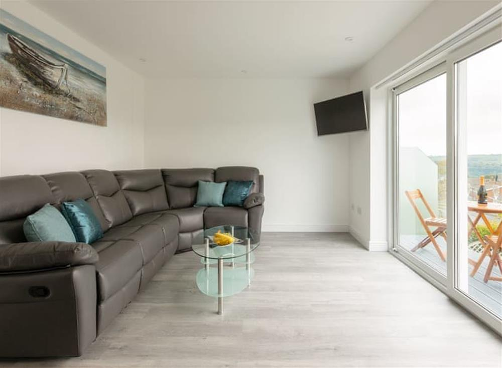 Spacious living room with sliding door to balcony at Grandview Dartmouth in Dartmouth, Devon