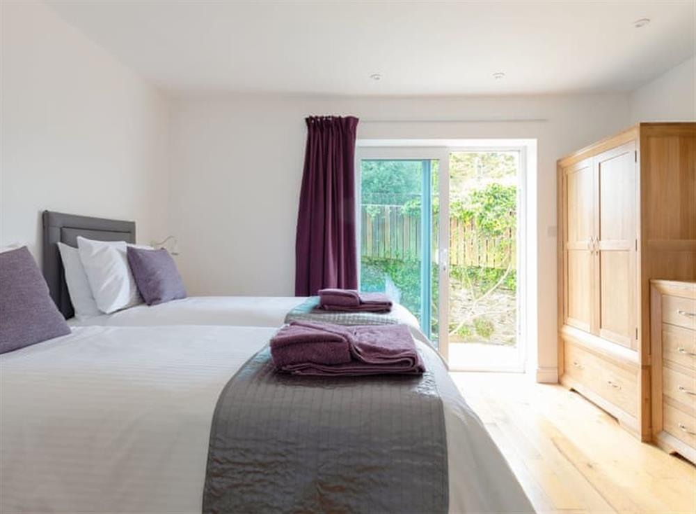 Twin bedroom with sliding door to patio at Grandview Dartmouth in Dartmouth, Devon