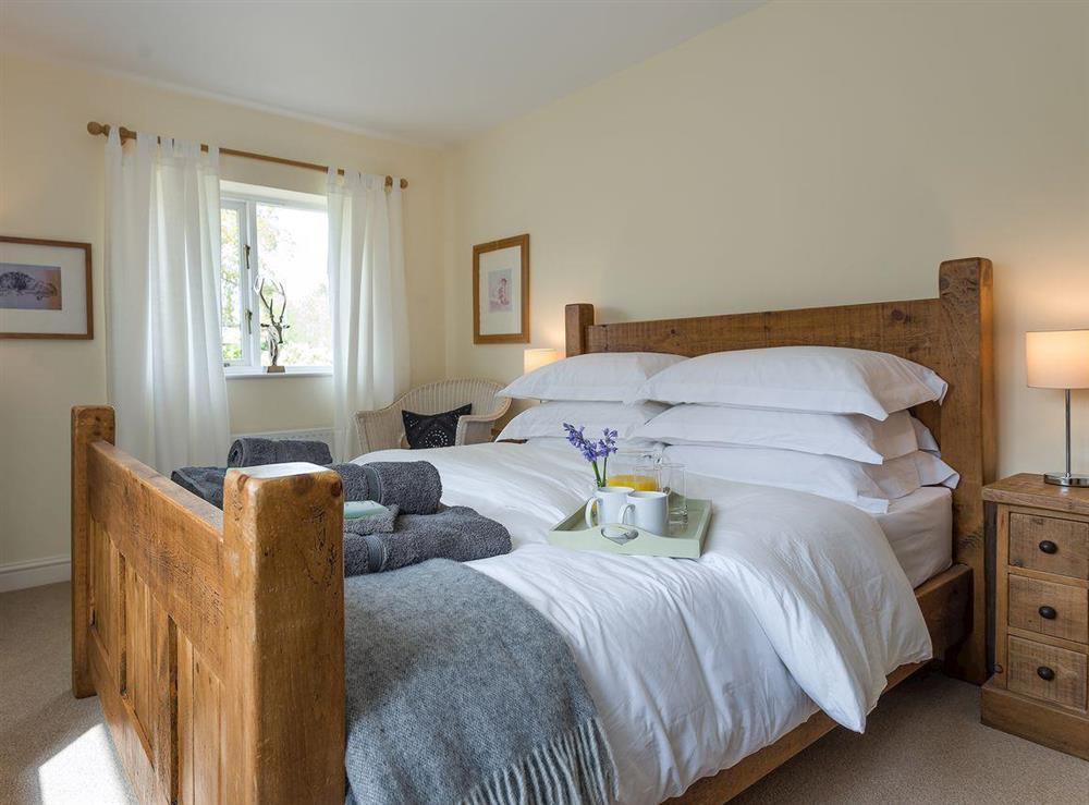 Double bedroom with TV at Grange Croft in Wymondham, near Oakham, Leicestershire, Norfolk