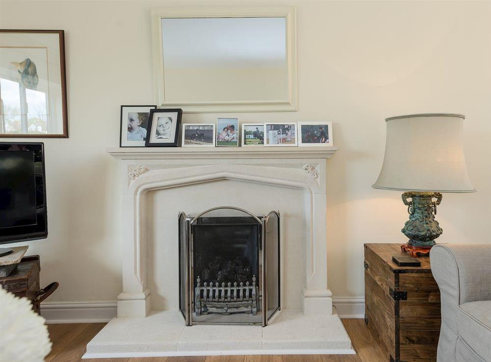 Living room with coal effect gas fire at Grange Croft in Wymondham, near Oakham, Leicestershire, Norfolk
