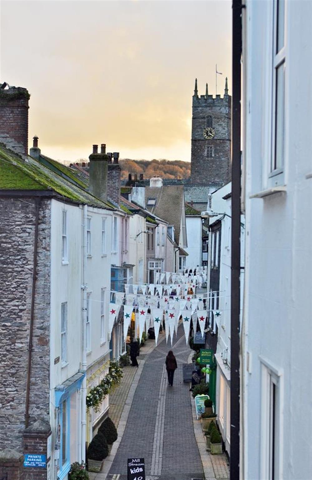 A bedroom view along Foss Street which is a shoppers delight! at Grants Cottage, Dartmouth