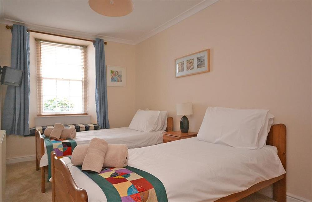 All bedrooms boast televisions and cosy window seats with views to the front of the property at Grants Cottage, Dartmouth