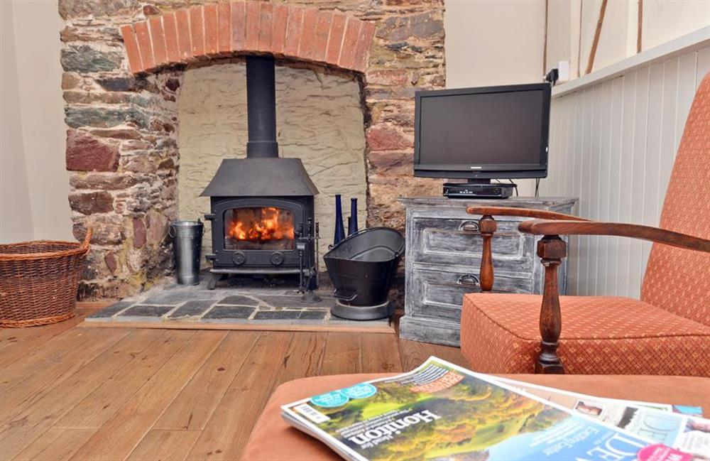 Enjoy the cosy sitting room with its wood burning stove at Grants Cottage, Dartmouth