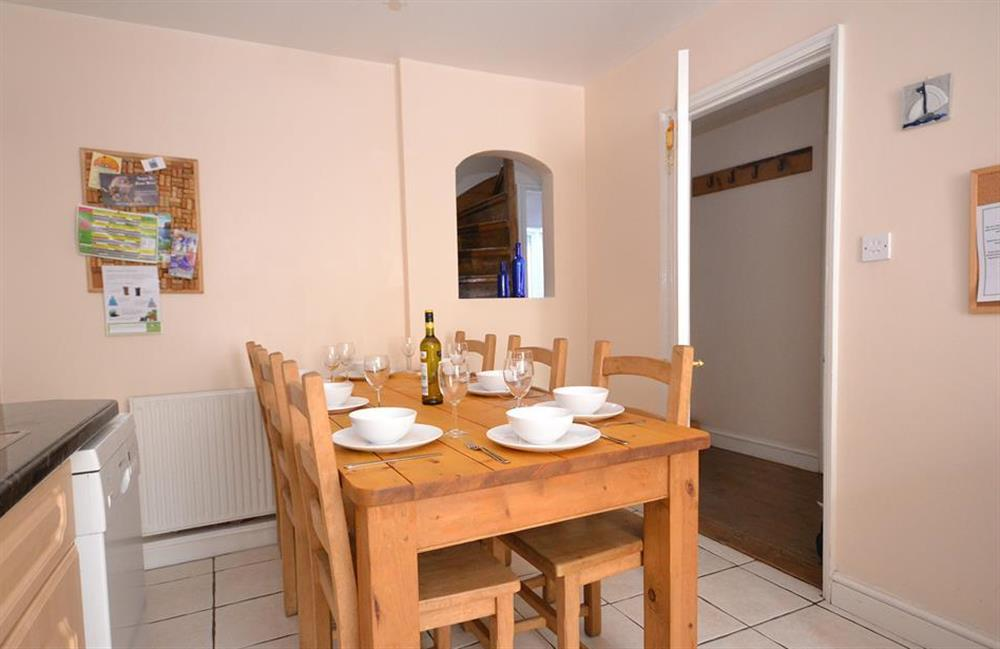 The dining table with 6 six chairs and two stools at Grants Cottage, Dartmouth