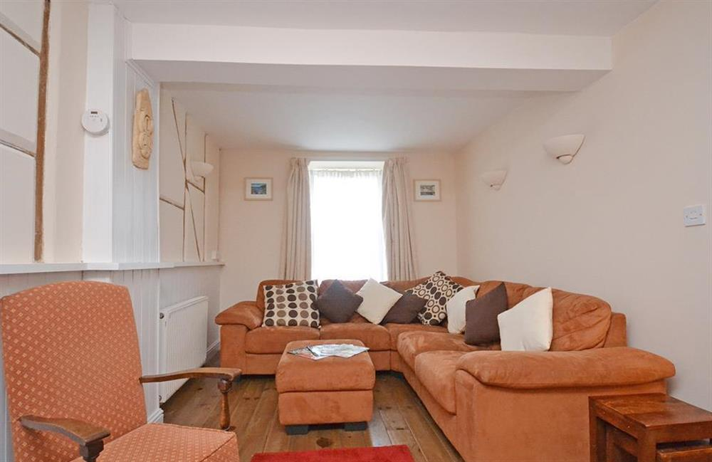 The sitting room with large comfortable corner sofa at Grants Cottage, Dartmouth