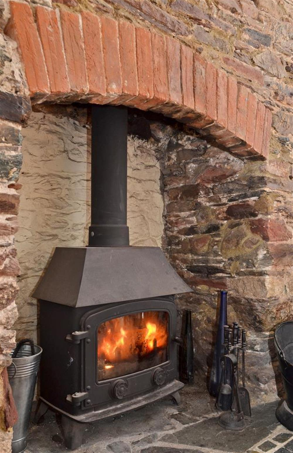 The warm and welcoming wood stove at Grants Cottage, Dartmouth