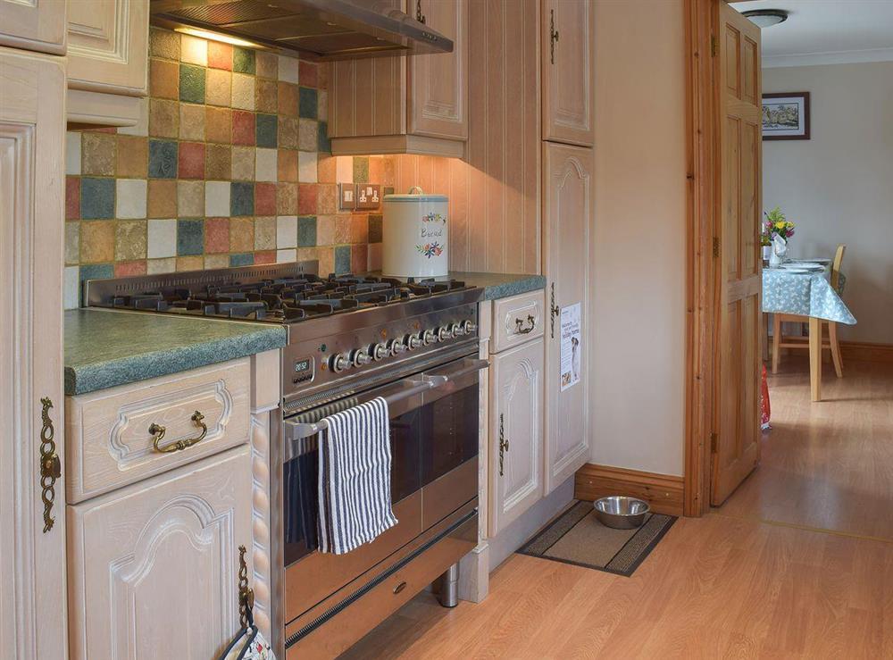 Farmhouse style kitchen at Grebe Cottage in West Somerton, near Winterton-on-Sea, Norfolk, England