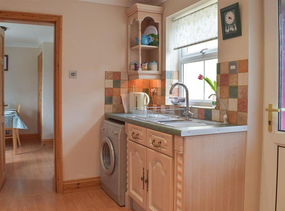 Fully equipped kitchen at Grebe Cottage in West Somerton, near Winterton-on-Sea, Norfolk, England