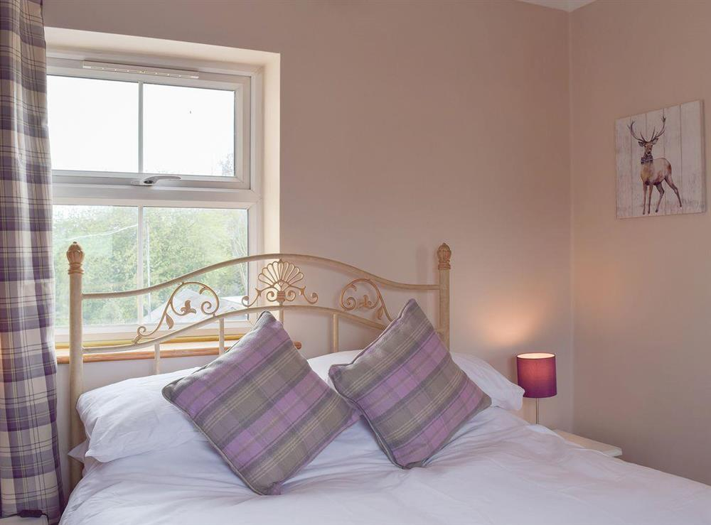 Romantic and inviting double bedroom at Grebe Cottage in West Somerton, near Winterton-on-Sea, Norfolk, England