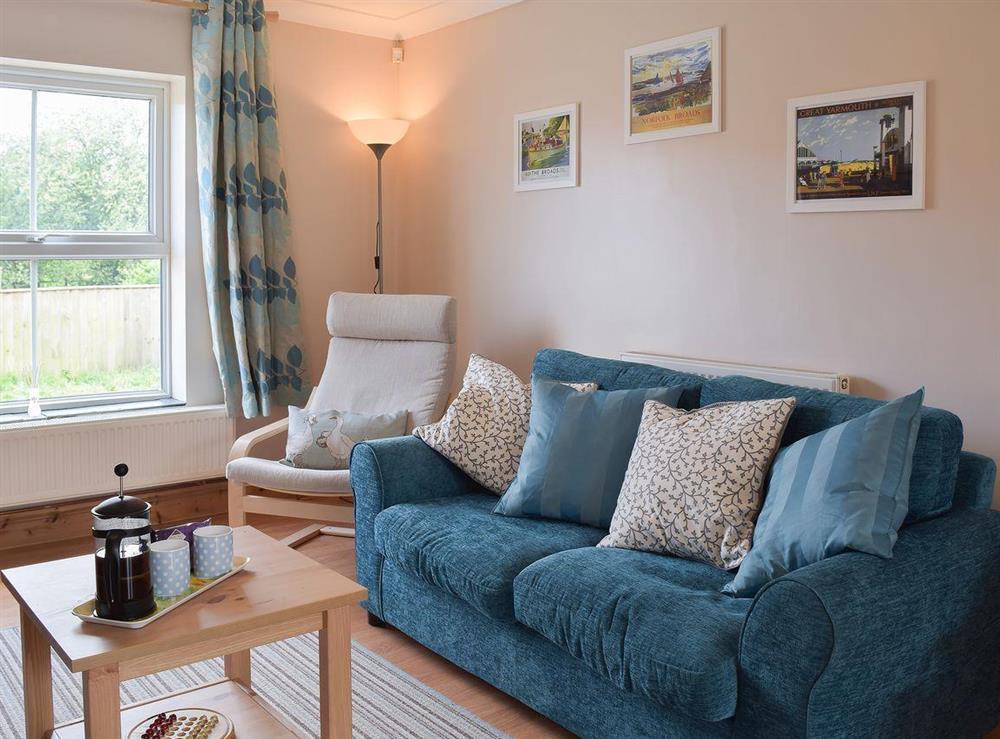 Spacious wood-floored living area at Grebe Cottage in West Somerton, near Winterton-on-Sea, Norfolk, England