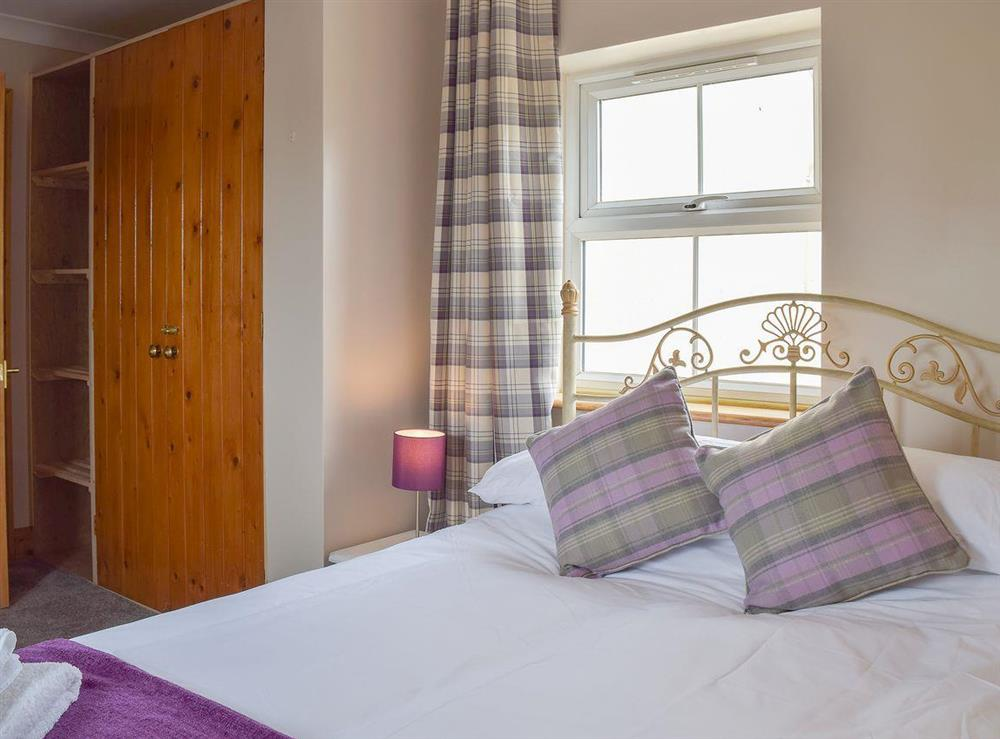 Welcoming double bedroom at Grebe Cottage in West Somerton, near Winterton-on-Sea, Norfolk, England