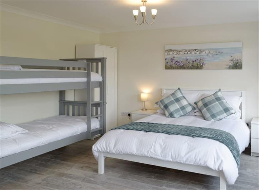 Ground floor en-suite bedroom with a double and bunk beds at Green Acres in St Dogmaels, near Cardigan, Cardigan, Dyfed