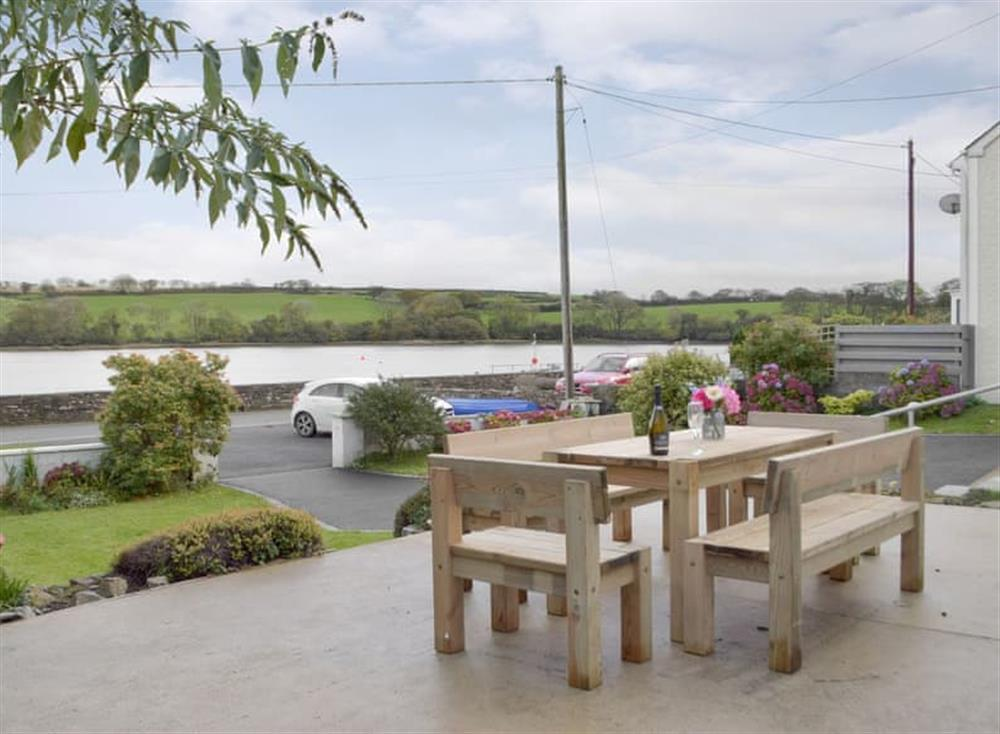 Patio area with views over the lake at Green Acres in St Dogmaels, near Cardigan, Cardigan, Dyfed