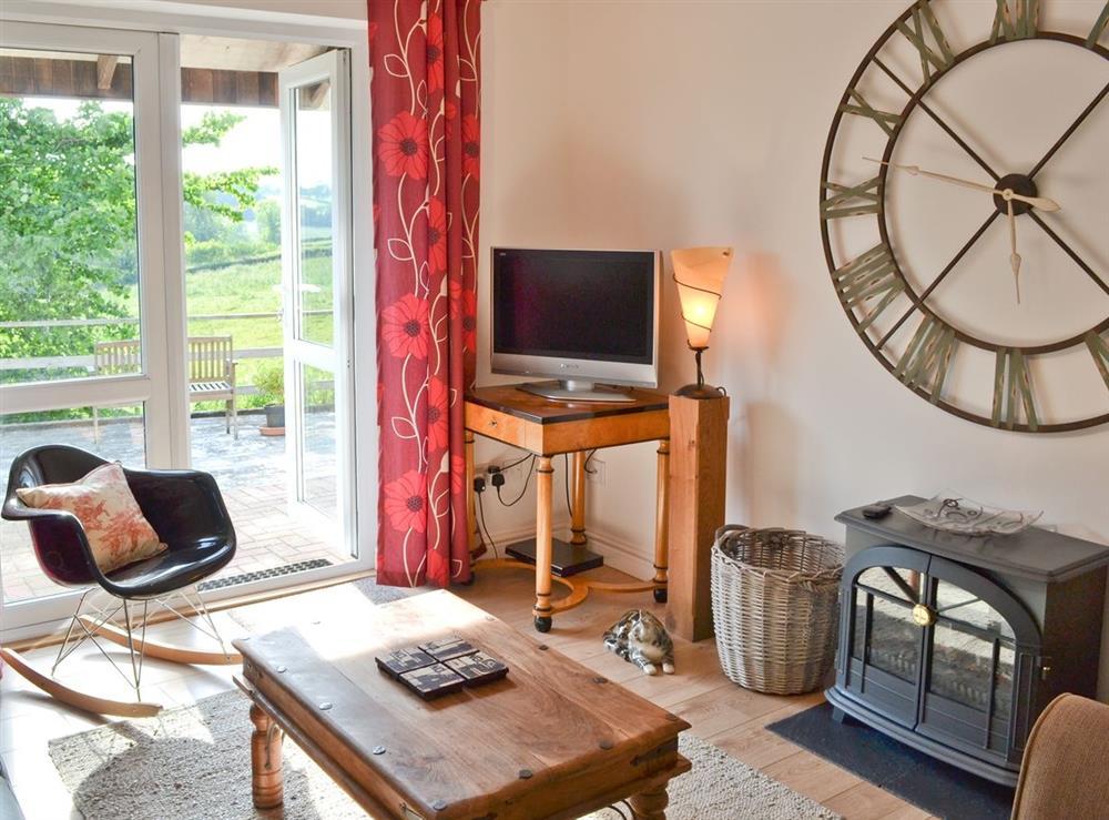 Living room at Green Oak Cottage in Sandley, near Gillingham, Dorset
