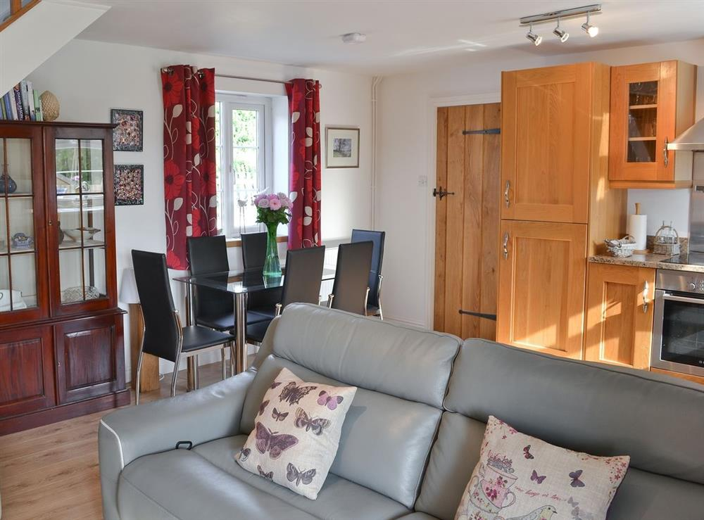 Open plan living/dining room/kitchen at Green Oak Cottage in Sandley, near Gillingham, Dorset